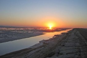 Sunrise at a vast salt lake