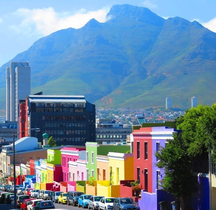 Colourful neighbourhood of Bo Kaap with Table Mountain looming in the background