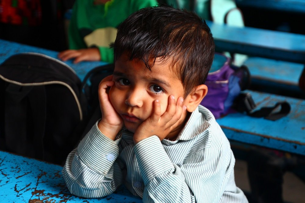 A lone boy in a poor local school we visited in Kathmandu