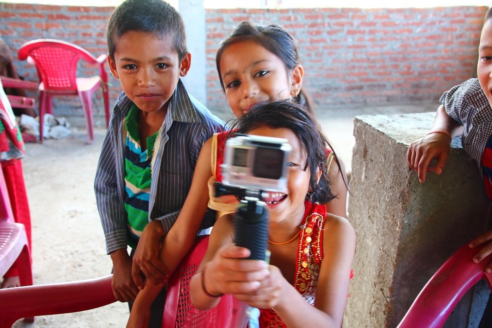 Local kids in Panauti take great thrill in filming with our GoPro as we witness a local festival.