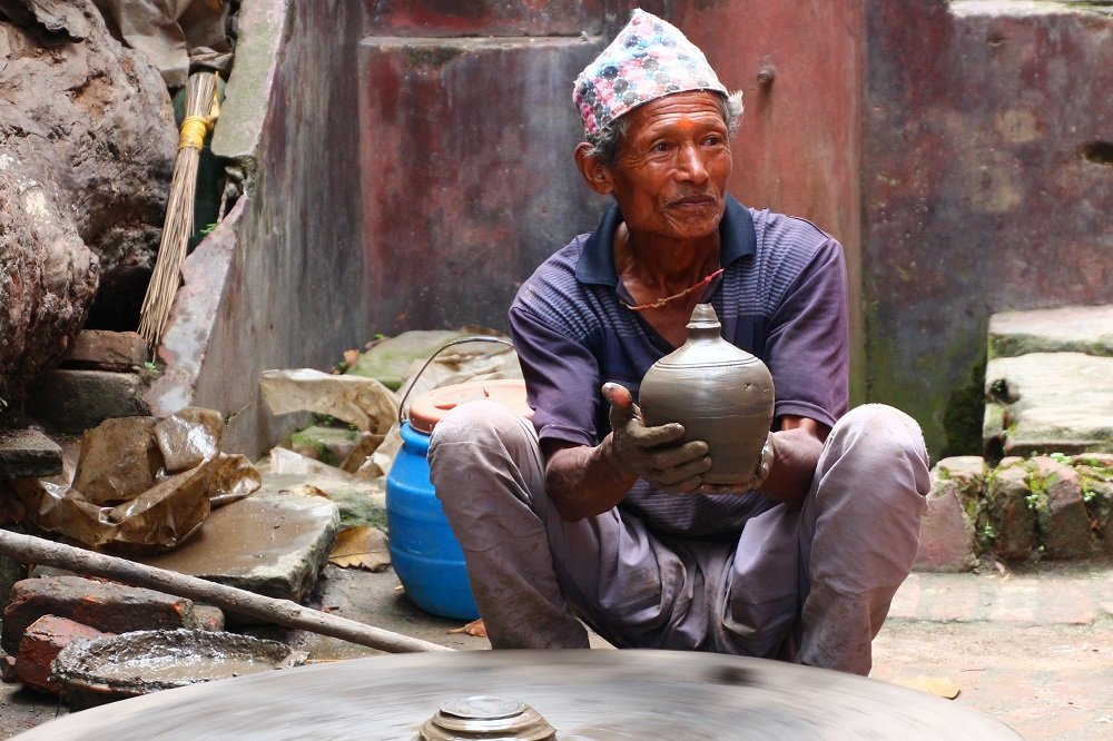 A local potter spins his wheel and whips up this vase in Pottery Square, Bhaktapur, Kathmandu Valley.