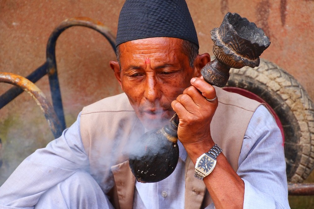Local man in Changunarayan, Kathmandu Valley smoking tobacco.
