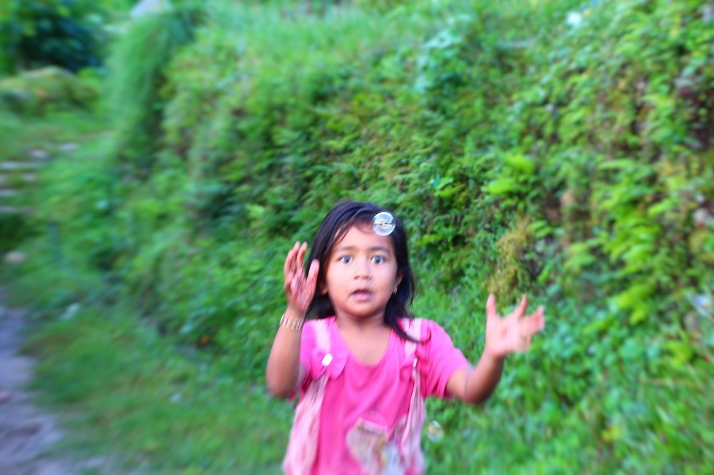 On an early morning hike to Sarangkot, I came across this little girl chasing bubbles.