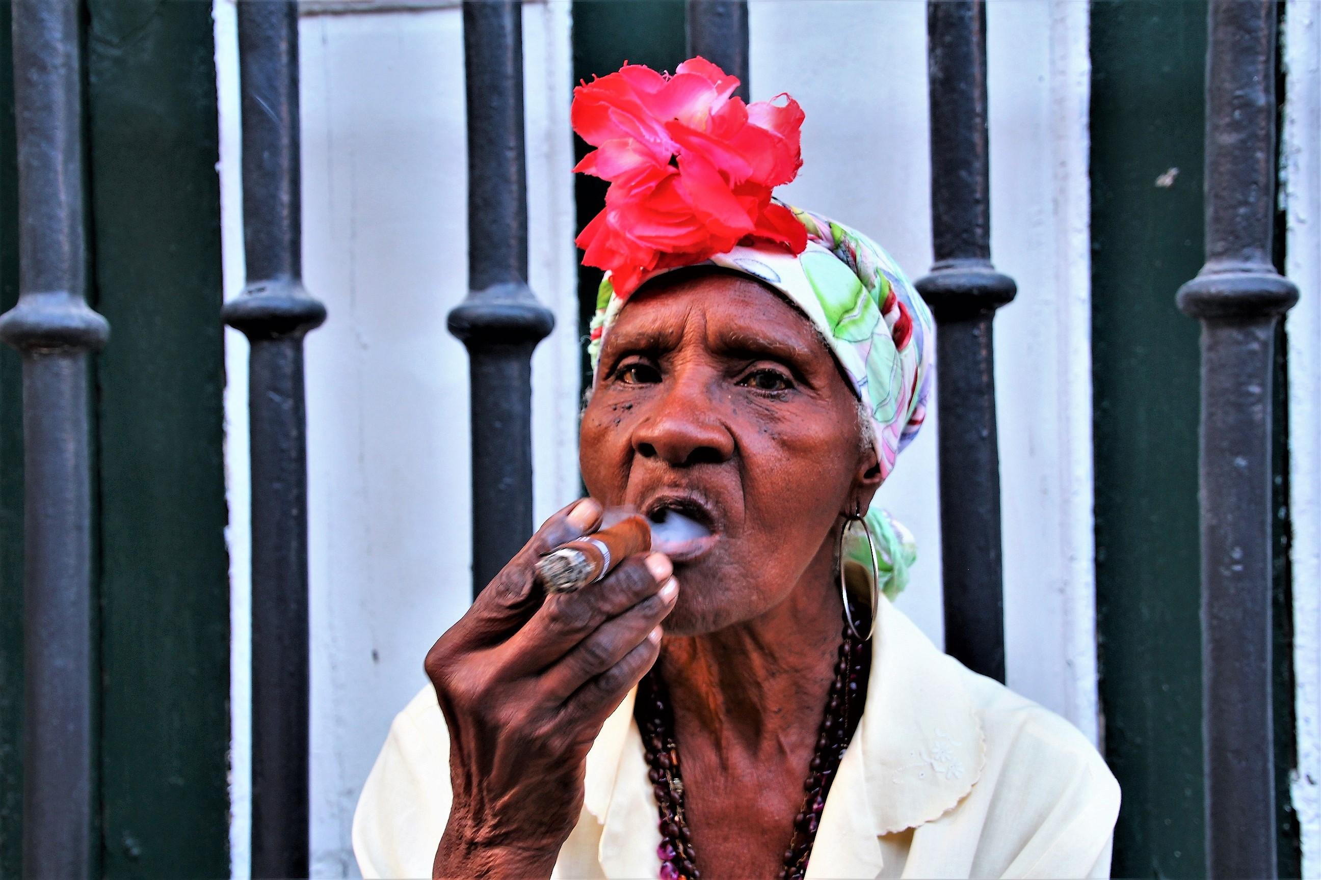 Lady smoking cigar, Old Havana, Cuba - Things to know about Cuba before you go - Crooked Compass