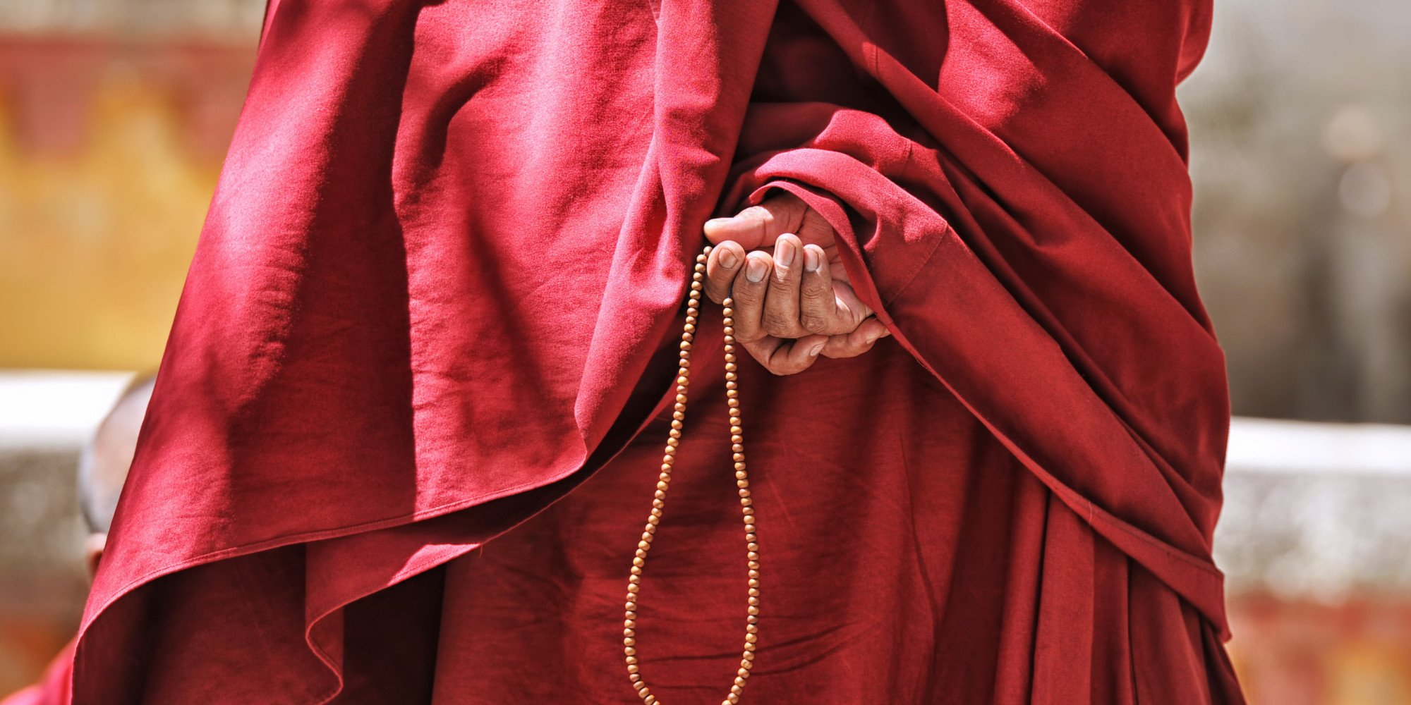 Tibetan Monk with prayer beads