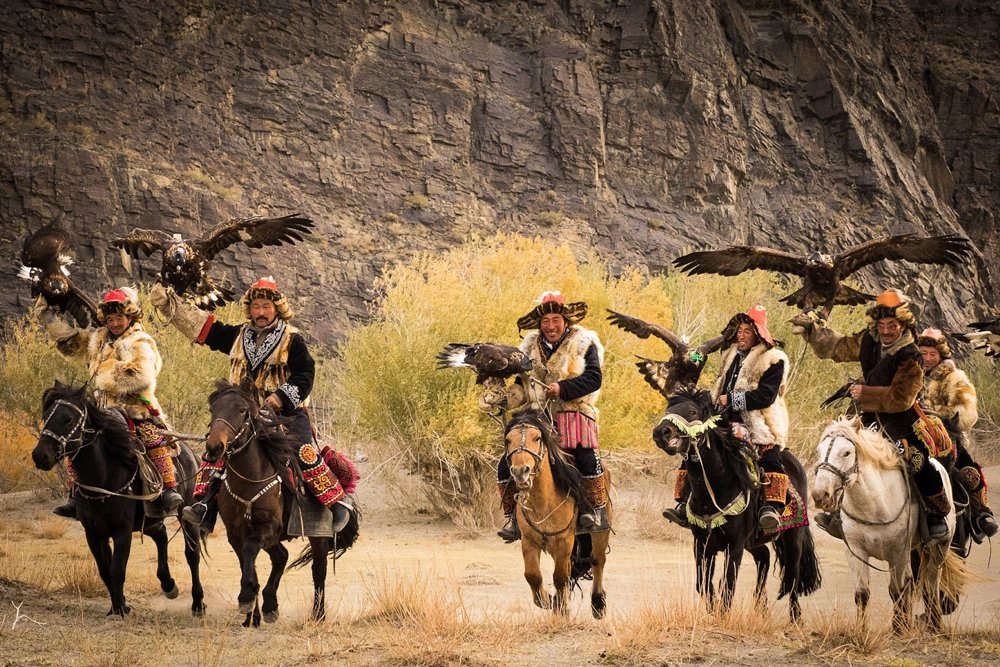 Kazakh hunters parade their Golden Eagles.