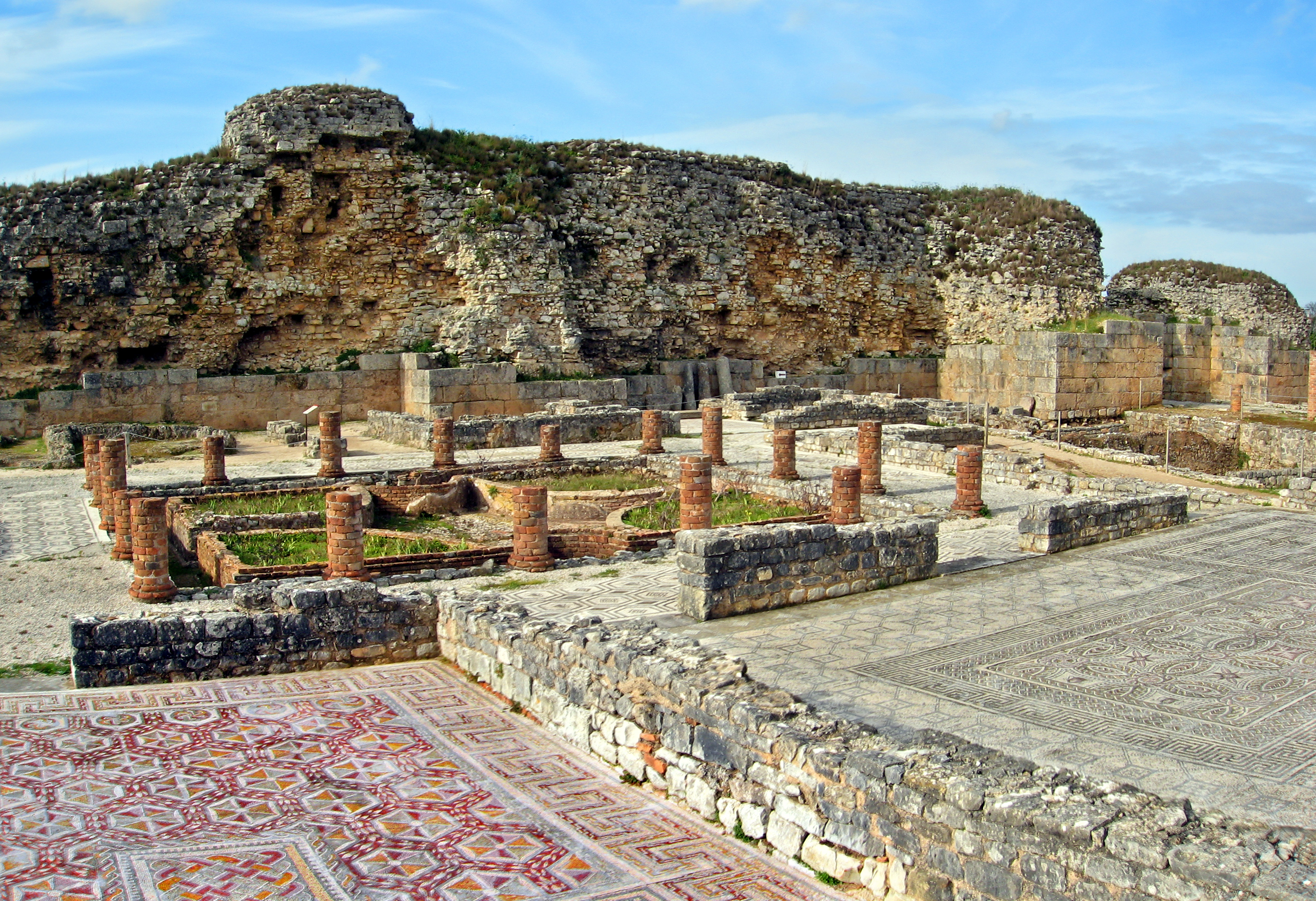 Mosaic tiles surrounding ruins at Conimbriga