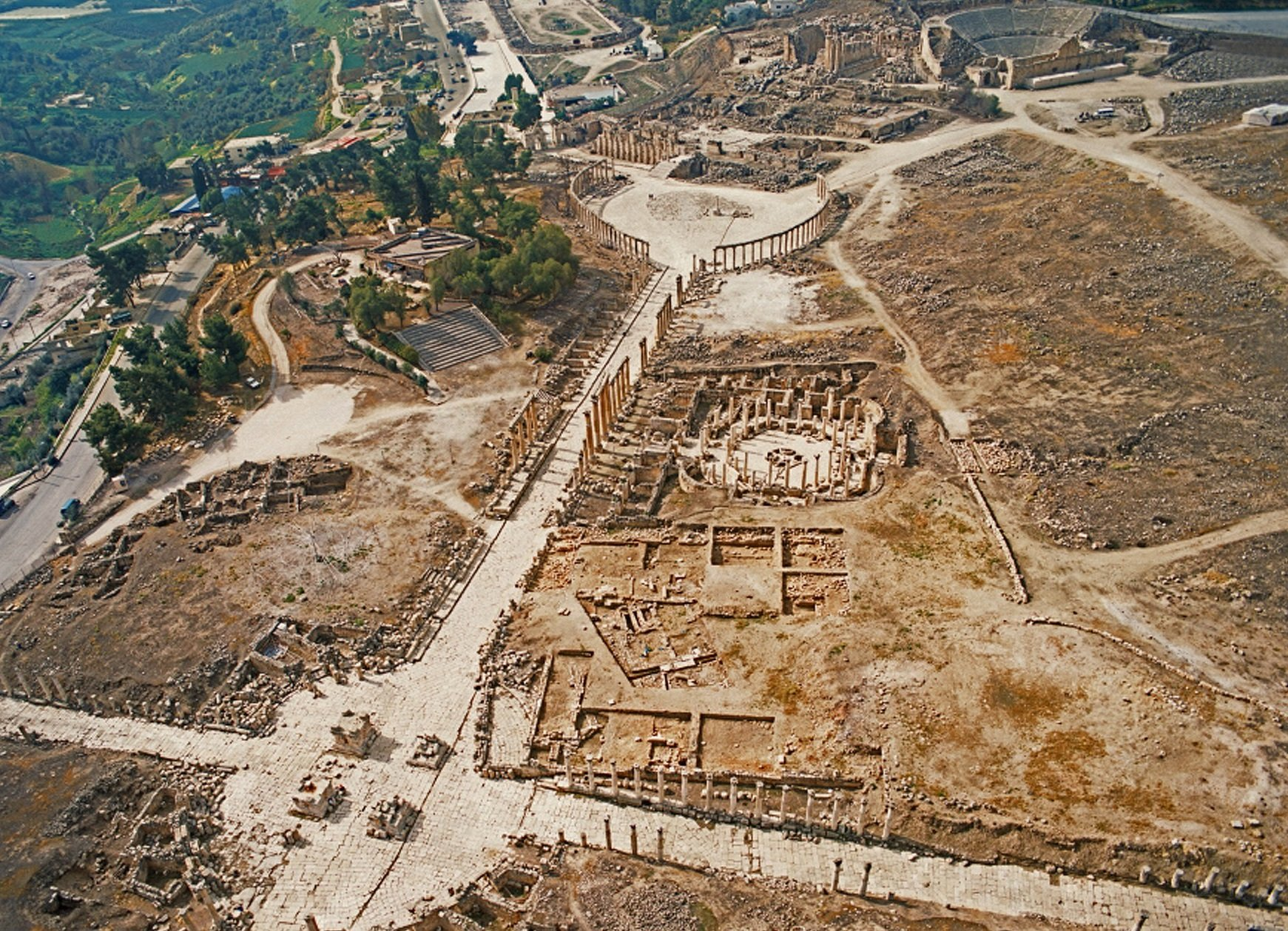 Aerial shot of Jerash featuring theatre and oval forum