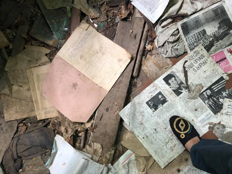 Entering a home in the Chernobyl Exclusion Zone still littered with newspapers from days before the accident.