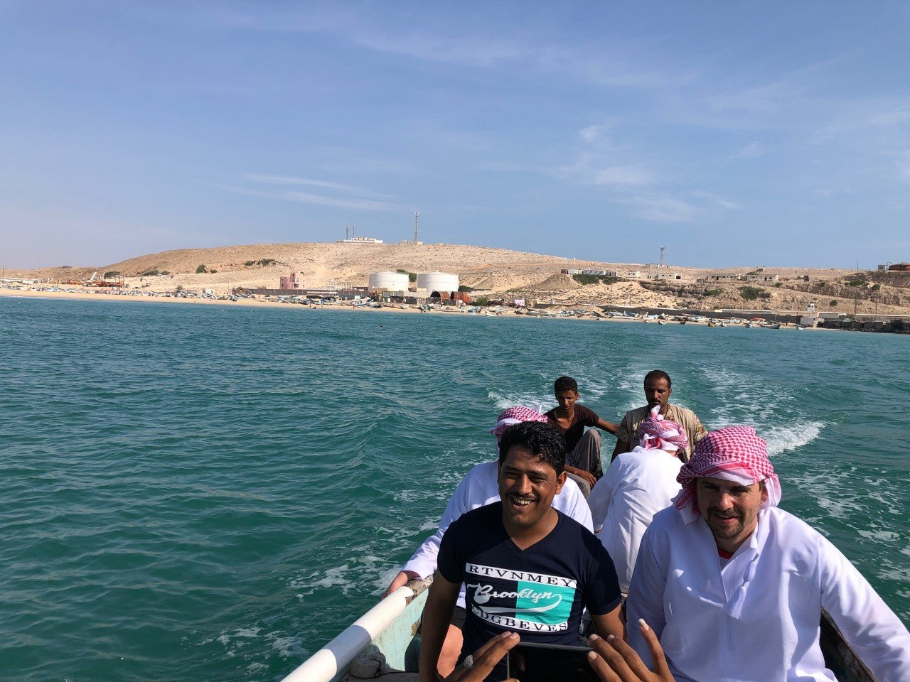 Cruising with the locals in a wooden fishing boat - we only capsized about three times and weren't sure if that shadow in the distance were pirates. Photo credit: Lisa Pagotto