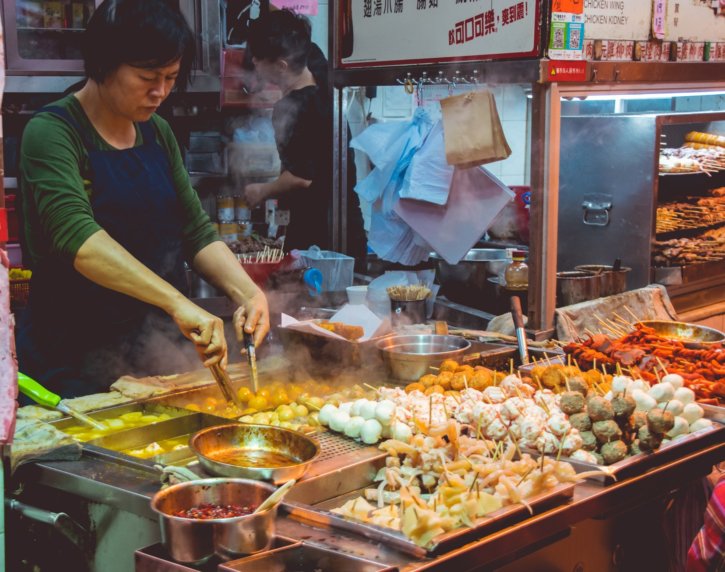 Asian street food vendors. Tim & Ness have a goal to keep our oceans pristine. Photo by Dylan Alcock on Unsplash