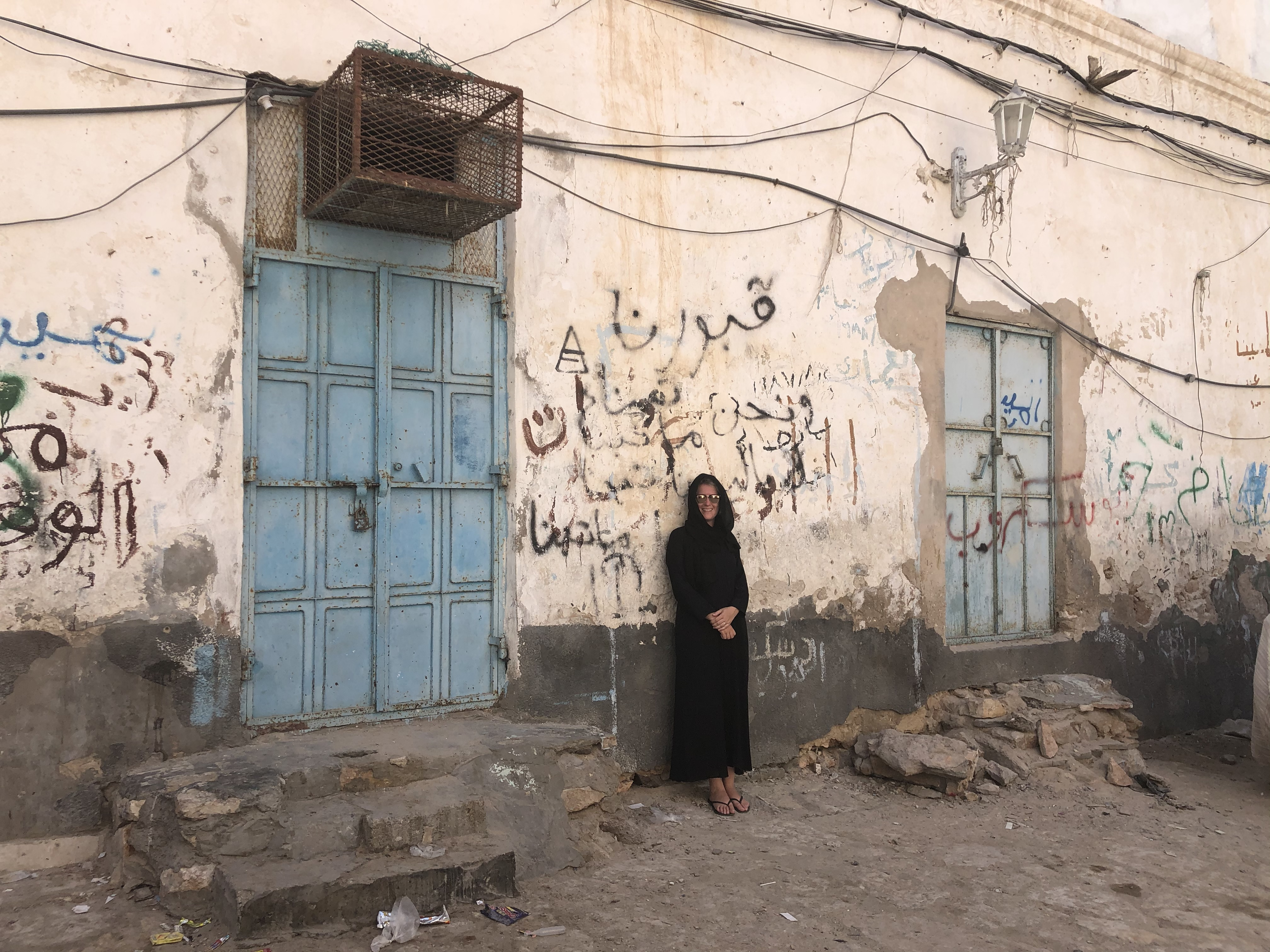 Lisa in the streets of the Old Town of Mukhalla, Yemen