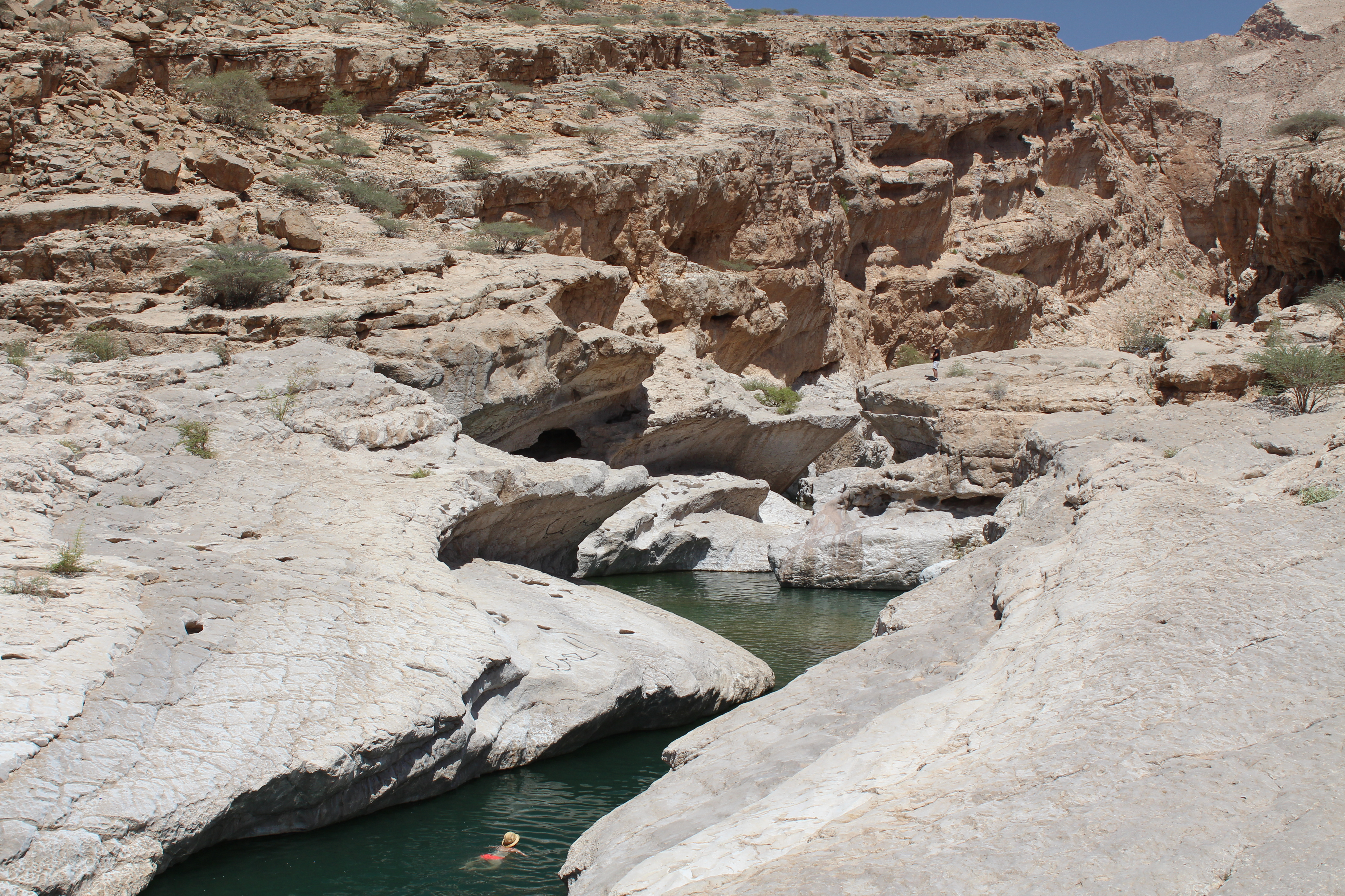 Lisa swims through Wadi Bank Khalid in Oman - at the end of this canyon was the waterfall Lisa fell down!