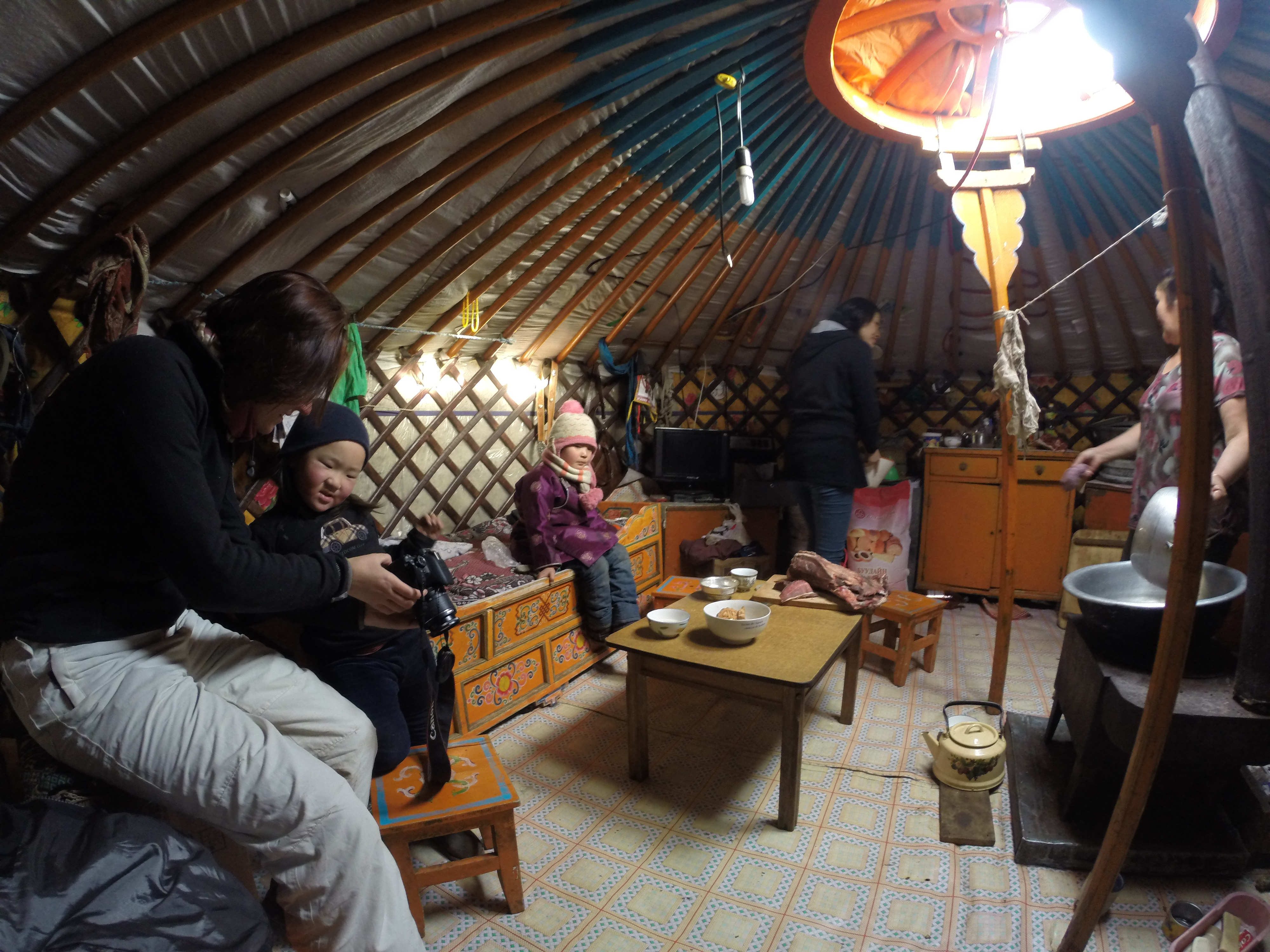 Family life inside a ger in Mongolia's wilds in the middle of winter.