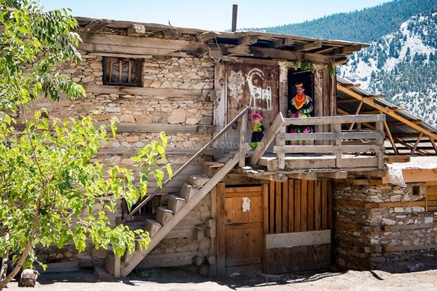 A traditional Kalash home tucked into the valley