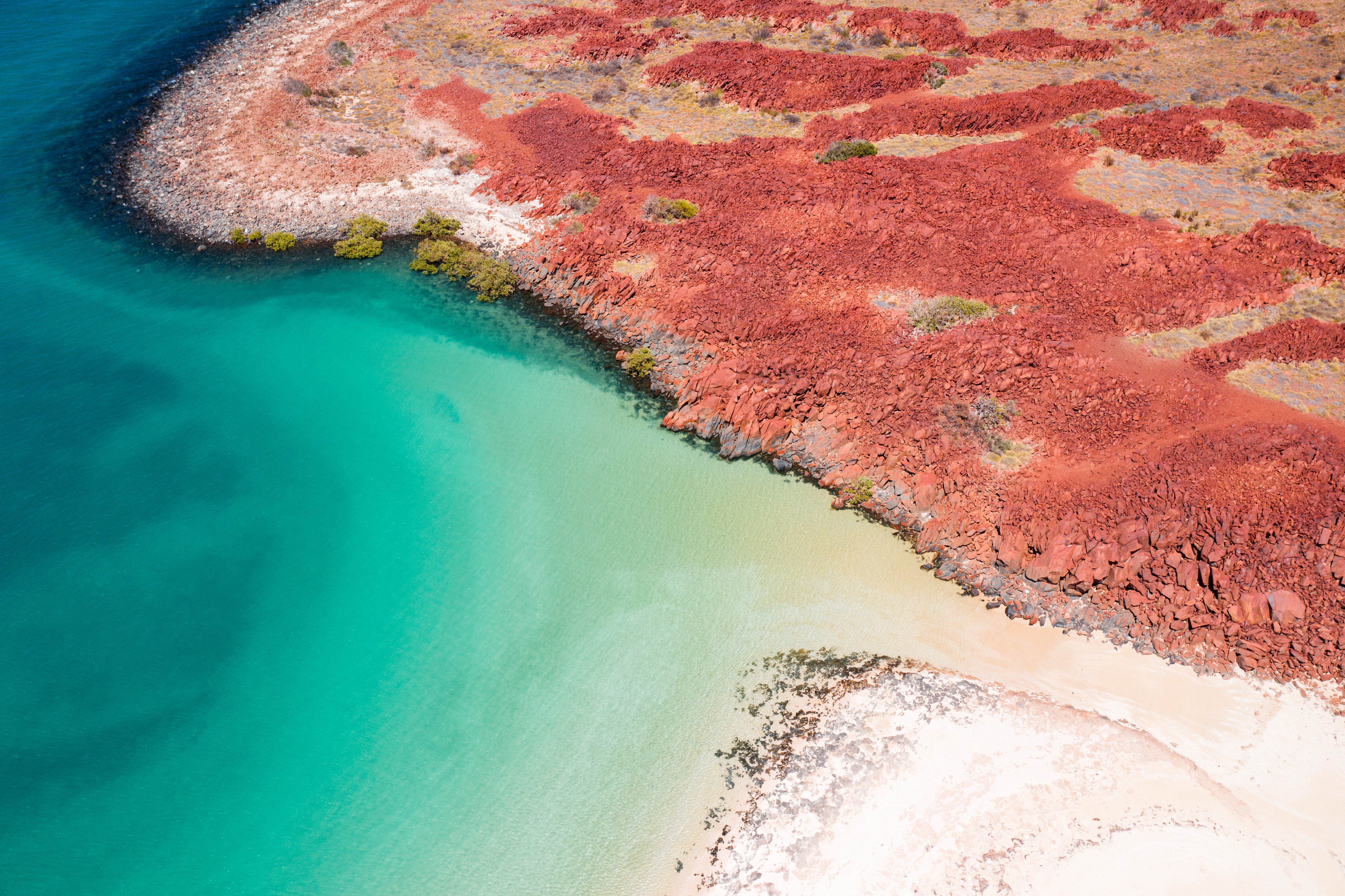 The contrasting blue hues and burnt red land of the Pilbara's Dampier Archipelago