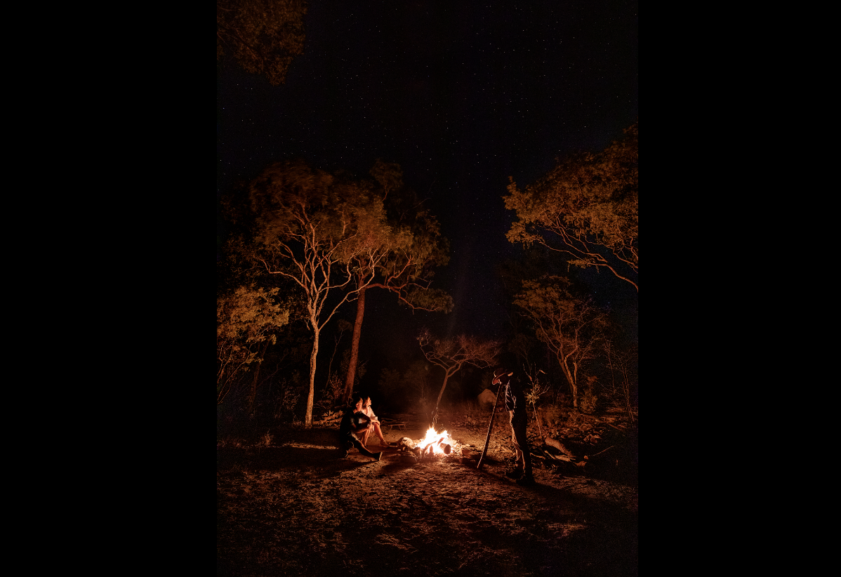 Johnny playing the didjeridoo around the camp fire